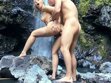 Enamored blonde Anikka Albrite is banged from behind over the waterfall